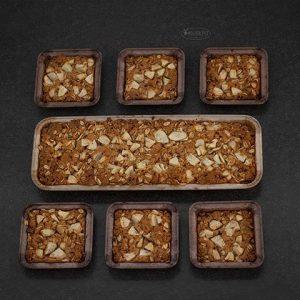 Appelplaat koek bakken in papieren bakvormen